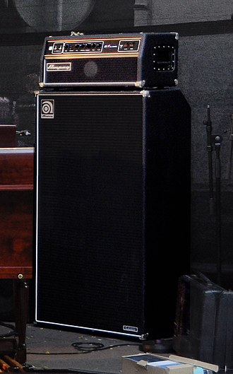 "Bass amplifier - An Ampeg SVT cabinet with eight 10"" speakers, with a separate Ampeg SVT amplifier ""head"" on top."