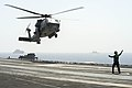 An SH-60F Seahawk lifts off. (8744195851).jpg