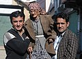 An elderly lady is escorted to a polling booth to cast her vote, at a polling booth of Theog, Distt. Shimla, during the Himachal Pradesh Assembly Election on November 04, 2012.jpg