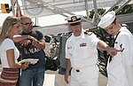 An officer explains the navy insignia..jpg