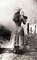 Annie Oakley shooting over her shoulder using a hand mirror..jpg