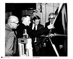 Armstrong looks at test apparatus with others.jpg