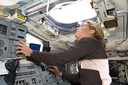 Astronaut Julie Payette looks through an overhead window on Space Shuttle Endeavour