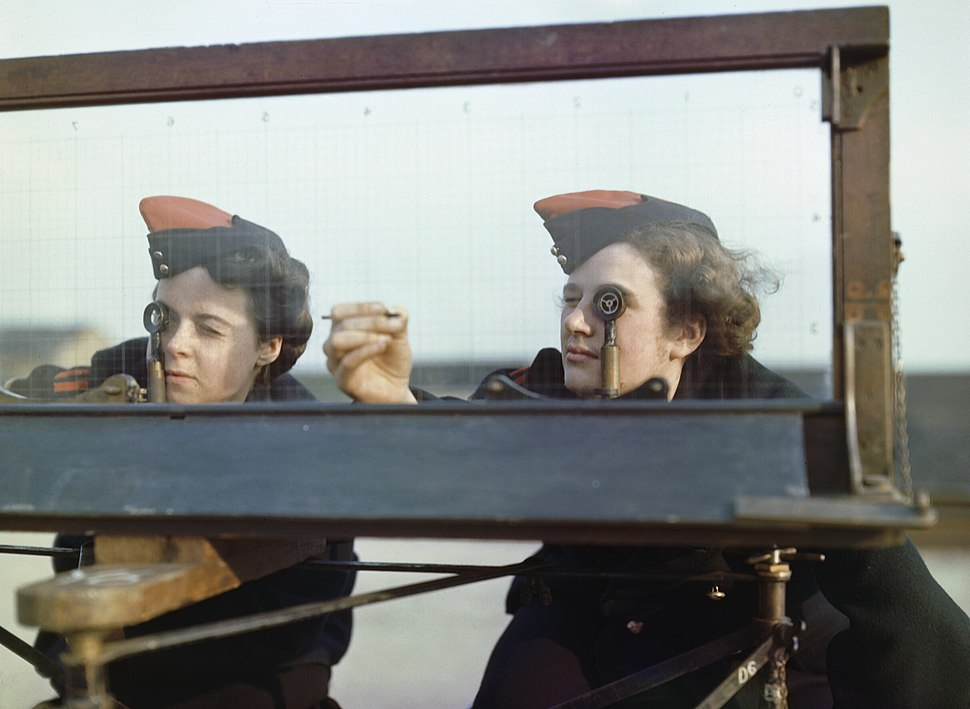 Auxiliary Territorial Service (ATS) girls at the Royal Artillery Experimental Unit, at Shoeburyness in Essex, using the Window Position Finder to sight shell bursts in the air or water, 1943. TR744