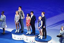 Awarding of winners in pair skating, World Figure Skating Championships in Helsinki 2017.jpg