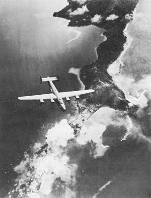 United States Army Air Forces in Australia - B-24 Over Salamaua, 13 August 1943. Note smoke from bomb bursts.