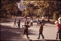 BOYS GETTING SOME FOOTBALL INSTRUCTION IN CENTRAL PARK - NARA - 551769.tif