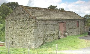 Bank barn - The same bank barn near Barras. The upper side has one double doorway for access to the threshing floor.