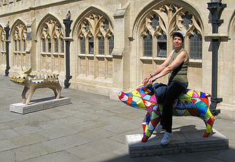 """CowParade - Two of the 104 decorated pigs on display in the English city of Bath. This was a public art event, called """"King Bladud's Pigs in Bath"""". Pig sculptures were on display around the city through the summer of 2008."""