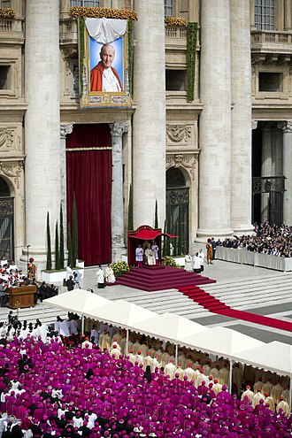 Beatification of Pope John Paul II - Following the Sacred Formula of Beatification, the banner revealing an image of a smiling John Paul II took place on the Central Loggia of St. Peter's Basilica.