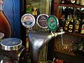 Beer taps at Pas Gerda (9614204469).jpg