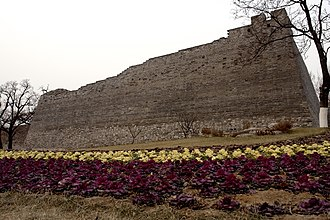 Beijing Ming City Wall Ruins Park - Flowers planted around the base of a partially restored bastion