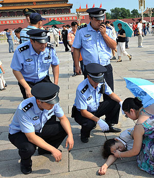 Ministry of Public Security (China) - Beijing Police helping a tourist.