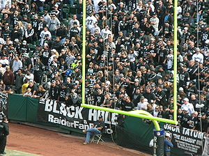 "Goal posts with a banner hung behind them reading ""Black Hole""."