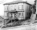 Boarding house on north side of Columbia St between 4th Ave and 5th Ave, Seattle, Washington, December 4, 1909 (LEE 207).jpeg