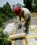 Bond beam work at Gabriela Mistral School construction site 150622-F-LP903-727.jpg