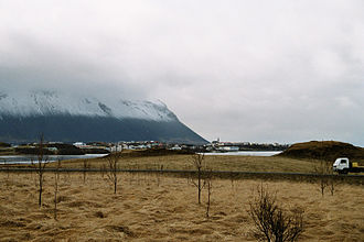 Borgarnes - Town of Borgarnes in wintertime with Mt. Hafnarfjall in the background, Iceland.