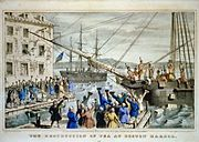 Two ships in a harbor, one in the distance. On board, men stripped to the waist and wearing feathers in their hair throw crates of tea overboard. A large crowd, mostly men, stands on the dock, waving hats and cheering. A few people wave their hats from windows in a nearby building.