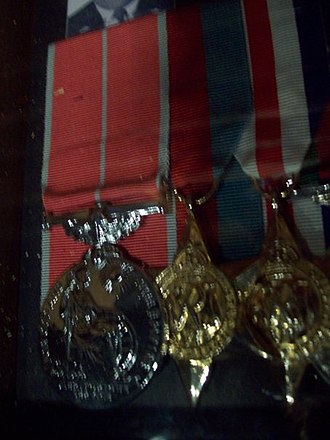 The Royal Canadian Regiment Museum - British Empire Medal, mounted with other medals, on display at the Royal Canadian Regiment Museum