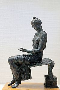 Bronze young girl reading CdM Paris.jpg