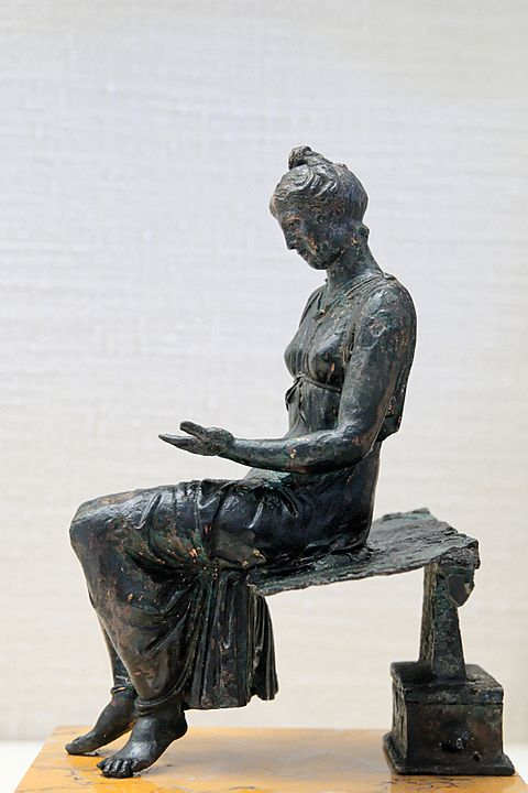 Bronze statuette of a young woman reading (latter 1st century) Bronze young girl reading CdM Paris.jpg