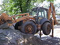 CASE 695 Super R backhoe loader on outriggers.JPG