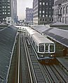 CTA Lake B Train turning onto inner Loop at Randolph and Wells station, Chicago, IL on June 13. 1968 (25613956450).jpg