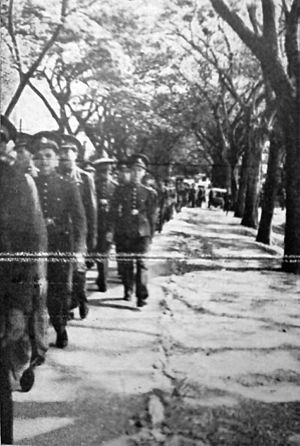 Triam Udom Suksa School - Class 1 graduates as they proceed towards the university campus during Chulalongkorn University's initiation ceremony, 1 June 1940