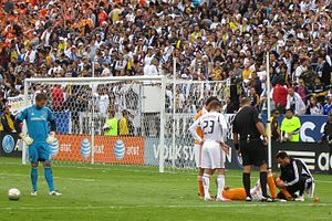 Houston Dynamo - Calen Carr lies injured as David Beckham looks on during the 2012 MLS Cup