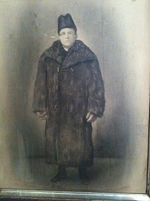 Fur clothing - A French-Canadian man, wearing a fur coat and hat, around 1910
