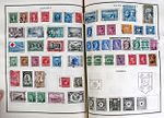 Canadian postage stamps on album pages.jpg
