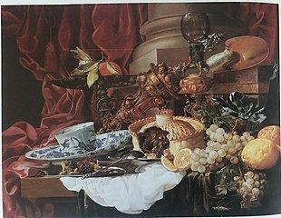 Sumptuous Still Life with Fruit and Pie, Tea Cup, Silvergilt Goblet holder, Covered Beaker, and Nautilus Shell