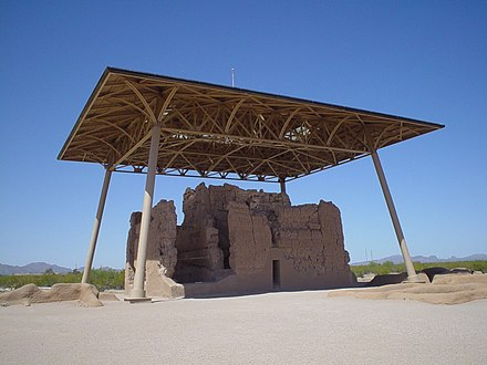 The distinctively modern-looking roof was built in 1932, to protect the Great House or Casa Grande, at the Casa Grande Ruins National Monument. Casa Grande under shelter.jpg