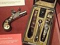 Cased box lock flintlock pocket pistols, Nicolas Noel Boutet, Versailles, c. 1805, ebony grips, engraved steel barrels - Royal Ontario Museum - DSC09482.JPG