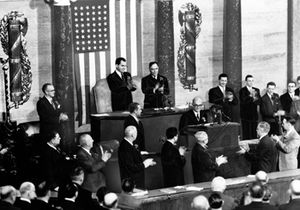 Celâl Bayar - President Celal Bayar of Turkey receives a standing ovation after his speech before a joint session of Congress. Behind him are Vice-President Nixon and Speaker of the House Sam Rayburn (1954).