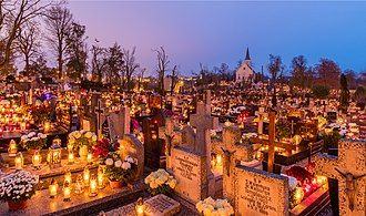 All Saints' Day - All Saints' Day at a cemetery in Gniezno, Poland – flowers and candles placed to honor deceased relatives (2017)