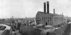 Black and white photograph of the building and the Gowanus Canal