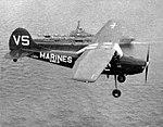 Cessna OE-1 of VMO-2 in flight near USS Philippine Sea (CVS-47) in 1958.jpg