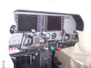 Glass cockpit - Garmin G1000 displays in a Cessna 182. Note the three analog standby instruments near the bottom of the main instrument panel.