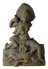 Chamunda, represented as a young, full-breasted goddess with flaming locks, bulging eyes and long fangs. Tamil Nadu, southern India
