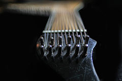 The longer bass strings are wound, and attached to the neck.
