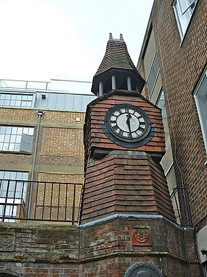 Toynbee Hall - Toynbee Hall, with its Arts and Crafts features, among buildings in London's East End