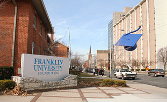 Square academic cap - Franklin University in Columbus, Ohio features a giant steel mortarboard suspended over the street as a landmark.