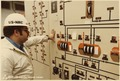 Control room Number 2. Nuclear Regulatory Commission inspector looking at meters. - NARA - 540034.tif