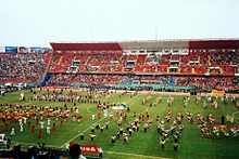 Photograph of an artistic show inside a football stadium