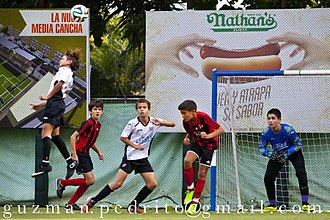 White Dominicans - Preadolescent boys playing association football in the Santo Domingo's middle-class neighborhood of Altos de Arroyo Hondo.