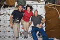 Crew Members Pose for a Photo on the Shuttle Atlantis Middeck (28072728372).jpg