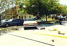 Crime scene photo of the FBI Miami shootout, showing suspect and agents' vehicles and battle debris. Photo by Miami-Dade PD.jpg