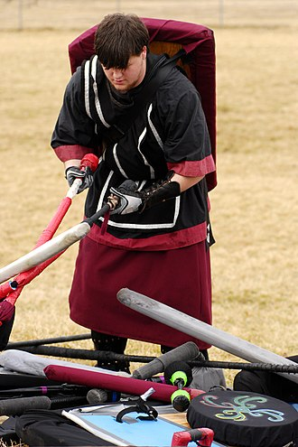 Foam weapon - A member of Dagorhir checking foam weapons and shields before a match for safety.