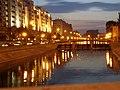 Dambovita River, Bucharest, Romania, at night.jpg